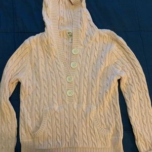 Light pink cable knit hooded sweater.